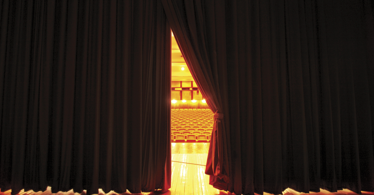 View of auditorium from behind theatre curtain